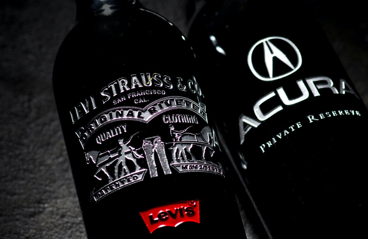 Two Custom Etched Wine Bottles laying down